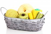Bright threads in basket isolated on white