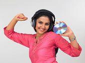 Woman Of Indian Origin Enjoying Music