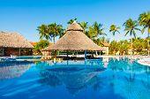 VARADERO,CUBA-NOVEMBER 4:Beautiful outdoors pool and bar at a hotel November 4,2012 in Varadero.With a million visitors per year,Varadero is the main destination for tourists visiting the island