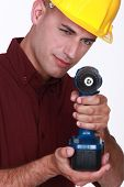 Man with cordless drill