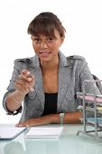 Woman at her desk reaching out