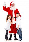 Happy Santa Claus with a couple of kids - isolated over a white background