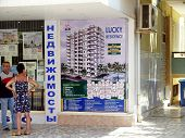 Alanya, Turkey - September 01, 2008: People Talking Near The Real Estate Agency On September 01, 200