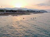 People Swim  In The Mediterranean Sea