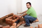 Worker Building A Brick Stove
