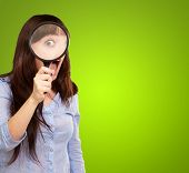 Woman Holding Magnifying Glass Isolated On Green Background