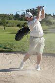 Jogador de golfe no Bunker de areia