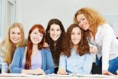 Portrait of young attractive women studying in university
