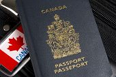 Closeup Of Canadian Passport Sitting On Suitcase
