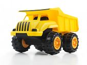 Yellow toy dump truck isolated on white background