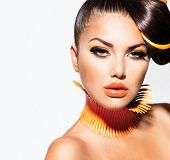 Fashion Model Girl Portrait with Yellow and Orange Makeup. Creative Hairstyle. Hairdo. Make up. Beau