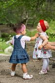Two Year-old Adorable Child Girls Playing On Nature Summer