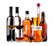 stock photo of mug shot  - different bottles and glasses of alcoholic drinks isolated on a white background - JPG