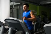 stock photo of treadmill  - Man running on treadmill - JPG