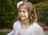 Beautiful Little Girl Portrait. Adorable happy face looking off camera