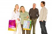 Family With Shopping Bag Isolated On White Background