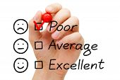 picture of dislike  - Hand putting tick mark with red marker on poor customer service evaluation form - JPG