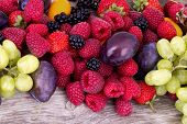 stock photo of blackberries  - tasty summer fruits on a wooden table - JPG