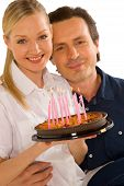 Couple Celebrating Birthday With Cake