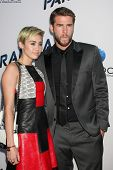 LOS ANGELES - AUG 8:  Miley Cyrus, Liam Hemsworth arrives at the