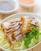Siu Yuk or sliced Chinese boneless roast pork with crispy skin, serve with steamed rice. Singapore C