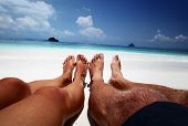 pic of pov  - Couple relaxing on a tropical beach - JPG
