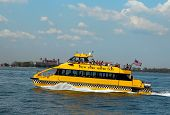 New York City Water Taxi in the front of Ellis Island