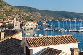 KOMIZA, CROATIA - AUGUST 19, 2012:  Yachts and boats in the harbour of Komiza on the island of Vis i