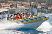 VIS, CROATIA - AUGUST 20, 2012: Tourists on taxi speed boat on the way to the island of Bisevo to se