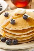 image of buttermilk  - Homemade Buttermilk Pancakes with Blueberries and Syrup for Breakfast