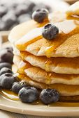 stock photo of buttermilk  - Homemade Buttermilk Pancakes with Blueberries and Syrup for Breakfast