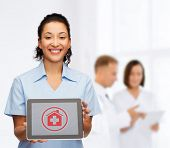 healthcare, medicine and technology concept - smiling african american female doctor or nurse with tablet pc computer