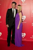 LOS ANGELES - JAN 24:  Eddie Cibrian, LeAnn Rimes at the 2014 MusiCares Person of the Year Gala in h