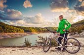 Young Man With Bike Enjoy With Beautiful Mountain Lake View