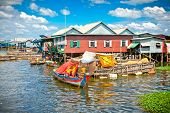 The floating village, caled Komprongpok, on the water of Tonle Sap lake. Cambodia.