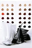 picture of hair dye  - Hair dye kit on board with hair samples of different colors background - JPG