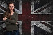 Beautiful Girl Over Grungy Uk Flag Background