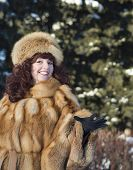 The Attractive Woman In A Fox Fur Coat Is Photographed In Winter Park.