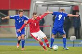 VIENNA,  AUSTRIA - MARCH 22 Marko Arnautovic (#7 Austria) and Hallur Hansson (#6 Faroe Islands) figh