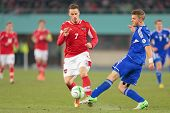 VIENNA,  AUSTRIA - MARCH 22 Marko Arnautovic (#7 Austria) and Rogvi Baldvinson (#5 Faroe Islands) fight for the ball during the world cup qualifier game on March 22, 2013 in Vienna, Austria.