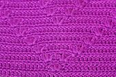 openwork knitting of purple yarn