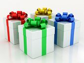 White Gift Boxes With Varicolored Ribbon