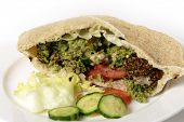 Egyptian flat bread stuffed with salad and falafels, a traditional fast food in the Middle East
