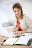 Businesswoman attending video conference from home