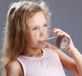 Child drinking water from glass