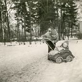 GERMANY, CIRCA FIFTIES - Vintage photo of mother and daughter in pram