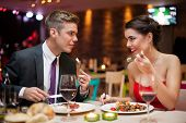 romantic couple in love on dinner in restaurant