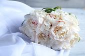 Beautiful wedding bouquet on  color wooden background