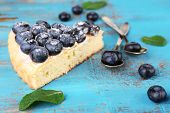 Tasty homemade pie with blueberries on wooden table
