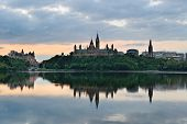 Ottawa city skyline at sunrise in the morning over river with urban historical buildings and colorfu
